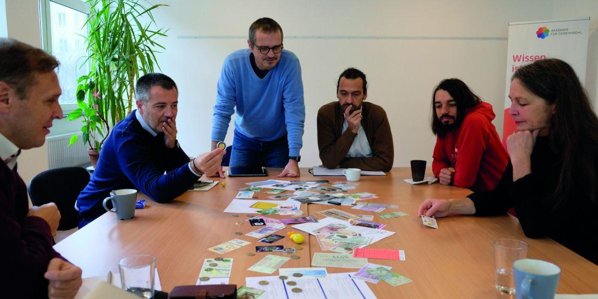 Gruppe Lehrgang Geld und Gemeinwohl